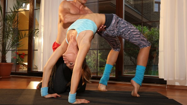 Flexible yoga girl stretched in gym at SexyHub.com