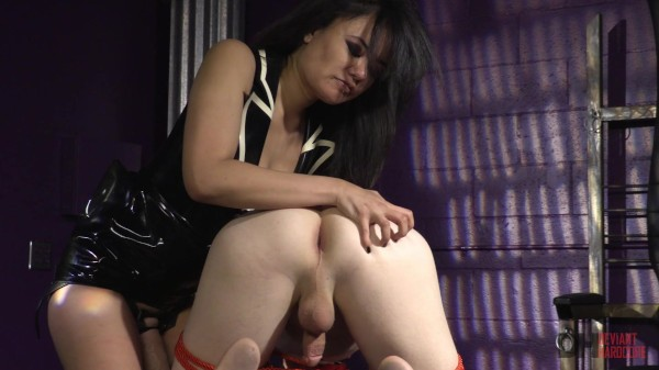 Sexy Asian Dominatrix Annie Cruz fucks her submissive slaves ass with a strap-on